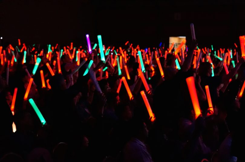 Glowsticks in the air at the closing of CHI 2015